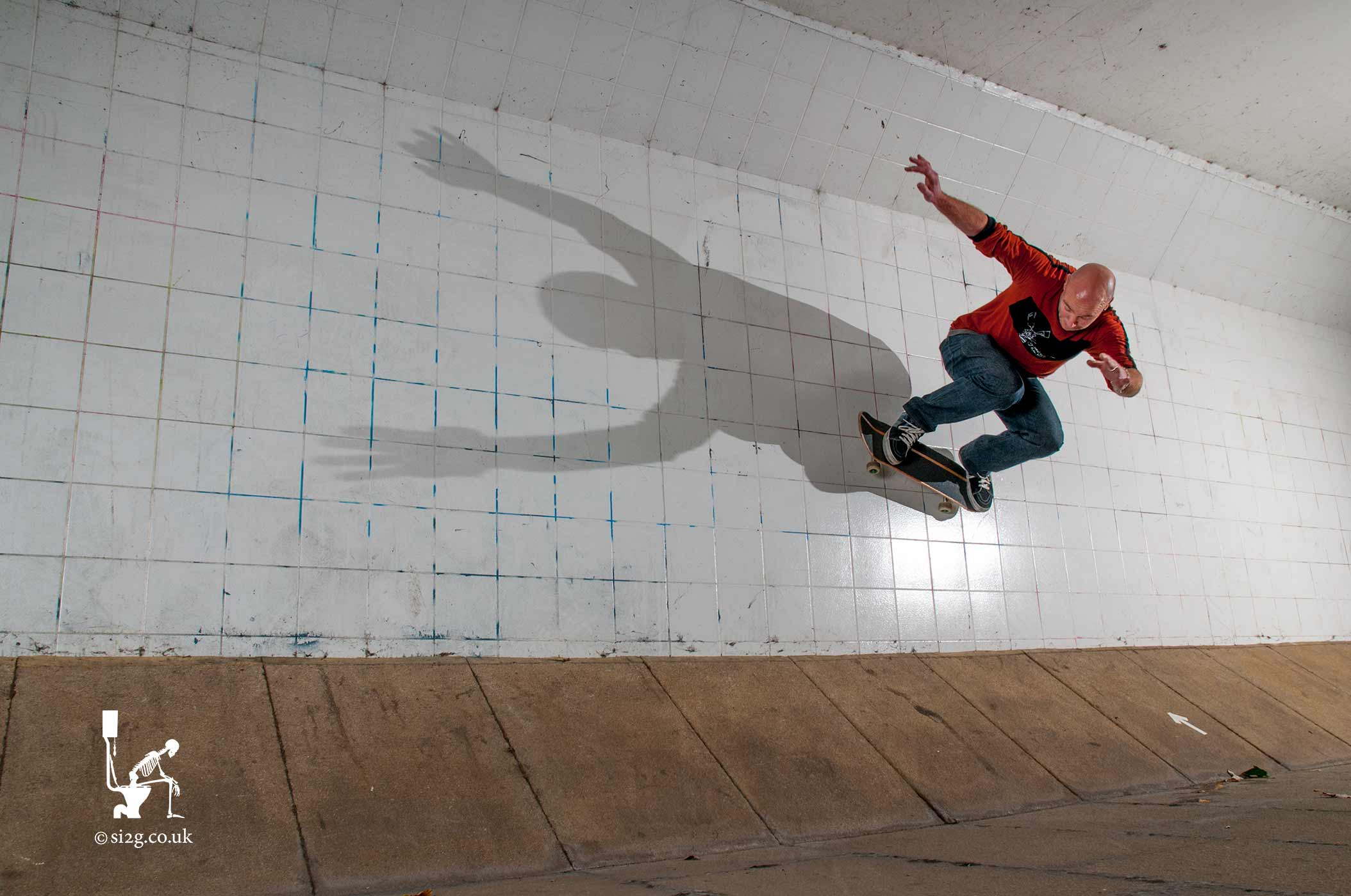 Skateboard Wallride - We set out specifically to capture this image of notorious skateboarder Martin Herrick performing a wallride on his skateboard, with his shadow stretched out across the wall.  In between busy waves of pedestrians using the under-pass Martin rode the wall, time-after-time, while minute adjustments were made to the lighting.