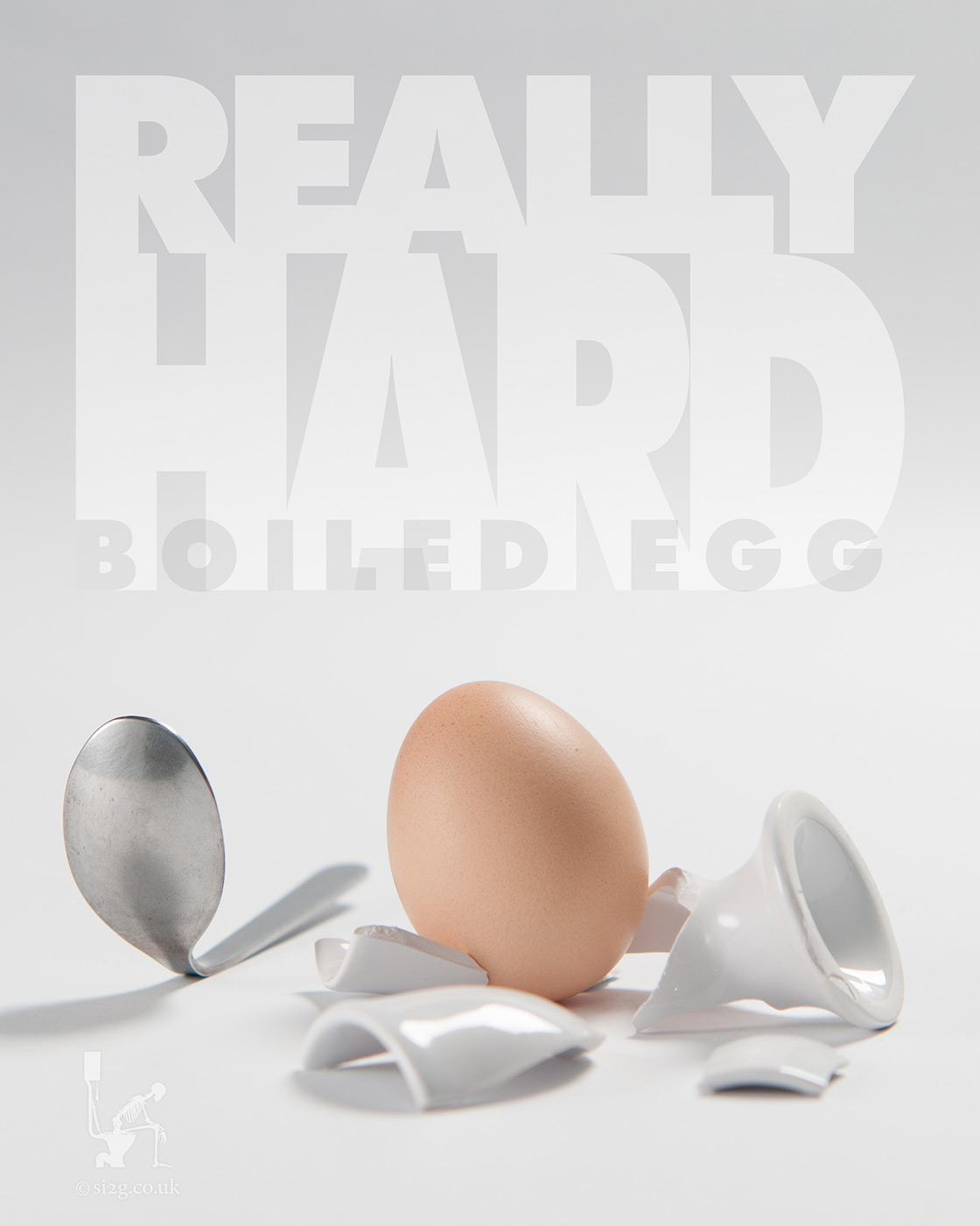 Really Hard Boiled Egg - A playful image showing what happens if you boil an egg for too long, featuring a hard-boiled egg, a smashed egg cup and a bent spoon.