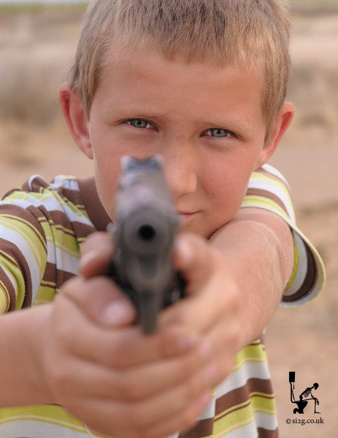 Child with Gun - This South African child has been taught to protect his village using live ammunition.